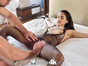 Latina Adrian Hush gets tied onto the bed in nothing but a fishnet